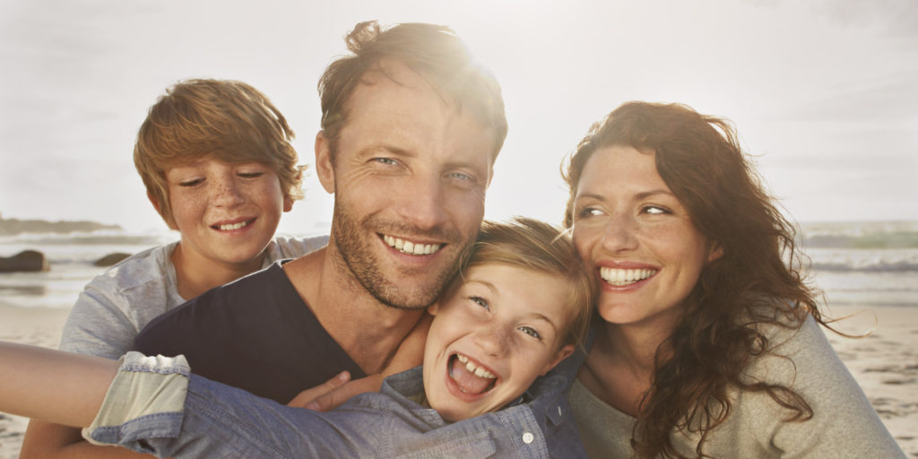 Portrait of family outdoors, close up