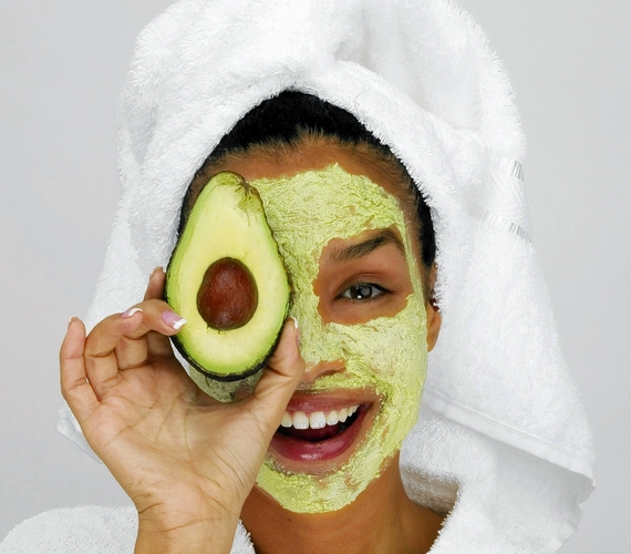 Portrait of a young woman wearing a facial mask holding a slice of avocado. Hill Street Studios, Blend Images via Getty Images ** OUTS - ELSENT, FPG, TCN - OUTS * NM, PH, VA if sourced by CT, LA or MoD **