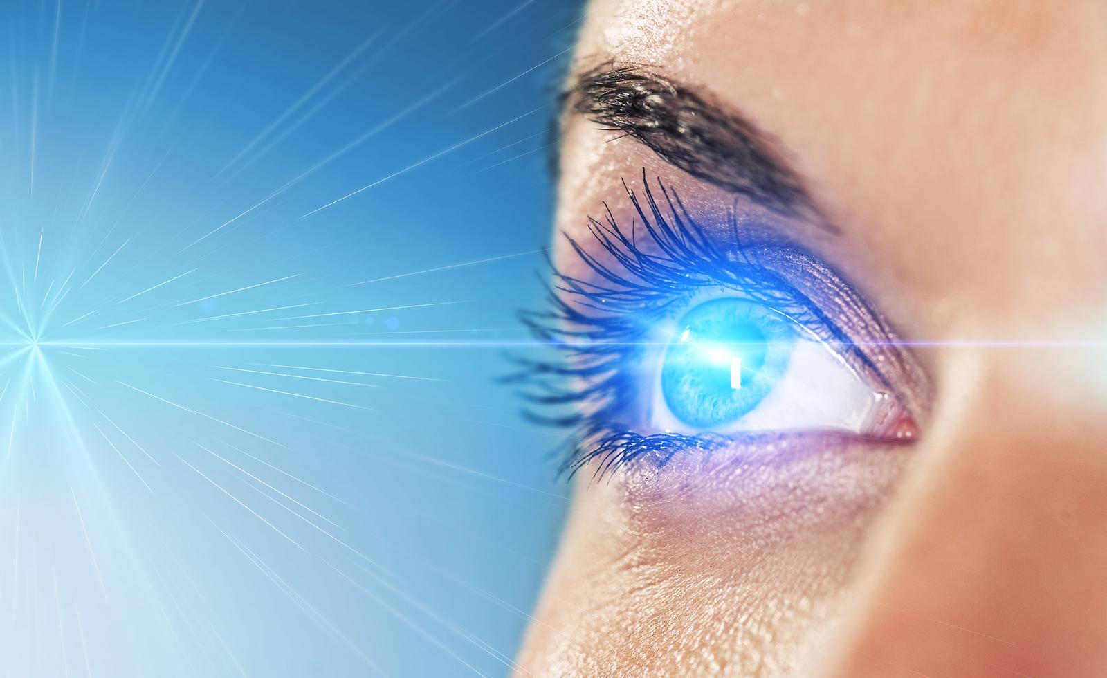 Eye on a blue background (shallow DoF)