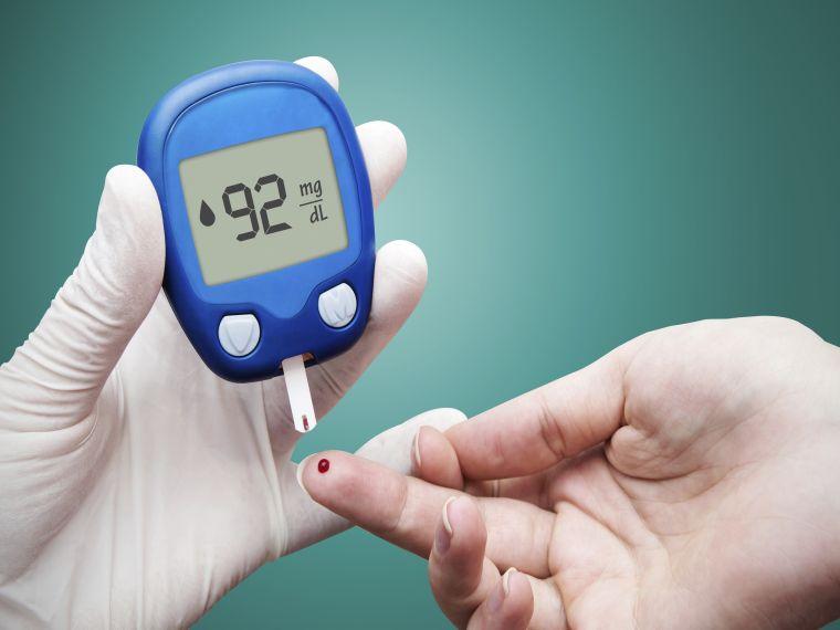 Doctor making blood sugar test. Hands with gloves