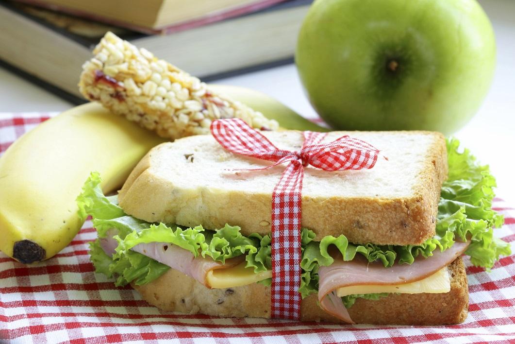 sandwich with ham, apple, banana and granola bar
