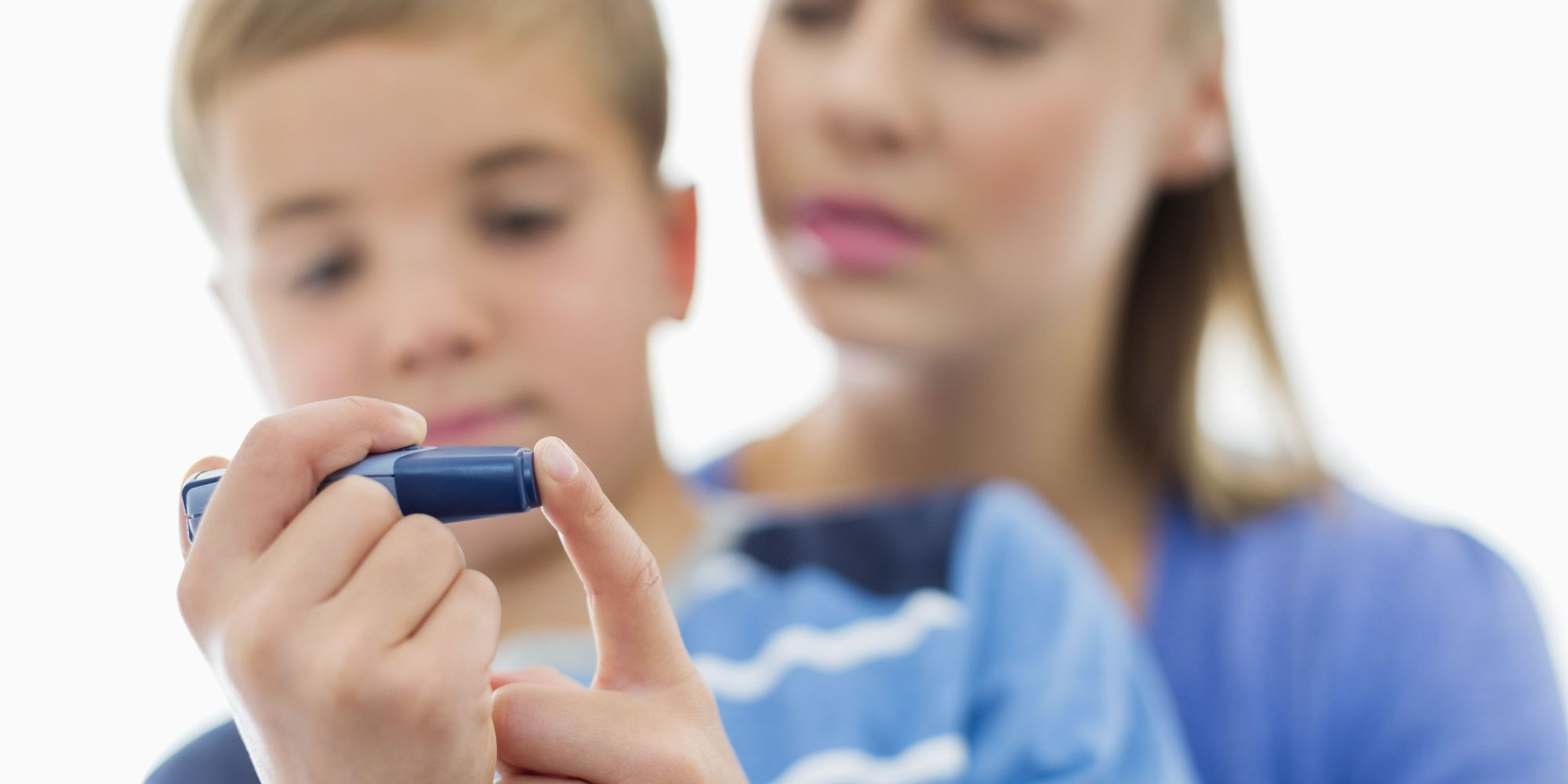 Mandatory Credit: Photo by Caiaimage/REX Shutterstock (2300551a) MODEL RELEASED, Mother helping son test blood sugar VARIOUS