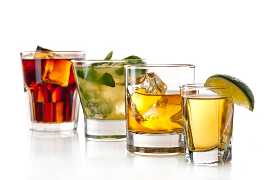 Three alcoholic cocktails and tequila shot