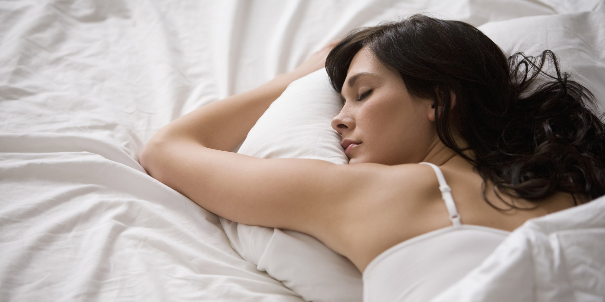 Caucasian woman sleeping in bed
